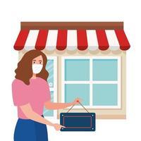 wieder geöffnet nach Quarantäne, Frau mit Etikett der Wiedereröffnung des Geschäfts, wir sind wieder geöffnet, Ladengeschäft Fassade