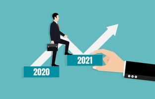 Der Geschäftsmann weist den Weg zu den Geschäftszielen im Jahr 2021 vektor