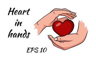 händerna håller ett rött hjärta.