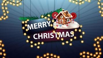 Frohe Weihnachten, Schild mit einer Girlande mit Weihnachtsbaumzweigen und Weihnachtslebkuchenhaus umwickelt
