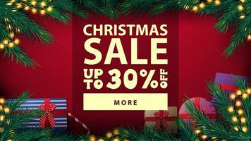 Weihnachtsverkauf, bis zu 30 Rabatt, schönes rotes Rabatt-Banner mit Weihnachtsbaumrahmen mit gelber Zwiebelgirlande und Geschenken, Draufsicht