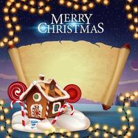 god jul, hälsningsvykort med pepparkakshus, gammalt pergament för din text och vackra vinterlandskap i bakgrunden