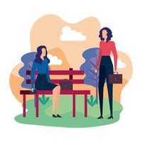 elegante Geschäftsfrauen sitzen im Parkstuhl