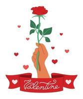 Hand hält rote Rose mit einem Band, das Valentinstag sagt.