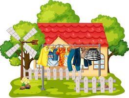 framför huset med kläder hängande på klädstreck vektor