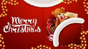 god jul, rött vykort i form av jultomtendräkt med present med nallebjörn i fickan