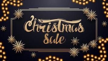 julförsäljning, mörkblå rabattbanner med krans, guld vintage ram och pappersguld snöflingor vektor