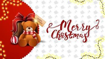 Frohe Weihnachten, rote und weiße Grußkarte mit Girlande und Geschenk mit Teddybär