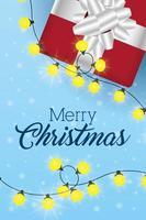 god julkort med gåva och lampor vektor