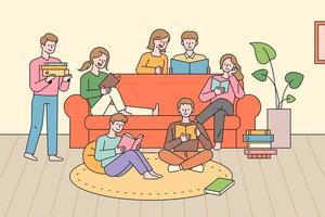 människor i en grupp som läser en bok.