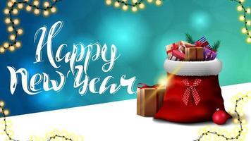 Frohes neues Jahr, blaue Grußpostkarte mit unscharfem Hintergrund und Weihnachtsmann-Tasche mit Geschenken