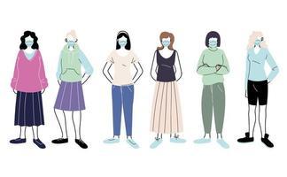 junge Frauen mit medizinischen Masken, die auf weißem Hintergrund stehen