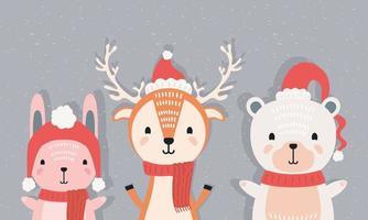 kanin med renar och isbjörn som bär julklädetecken vektor