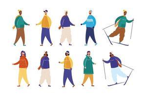 Interracial Menschen tragen Winterkleidung und Skifahren