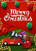 god jul, vertikalt rött och grönt vykort i materialdesignstil med ballonger och röd veteranbil som bär julgran
