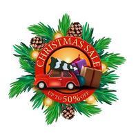 Weihnachtsverkauf, bis zu 50 Rabatt, rundes Rabatt-Banner mit Weihnachtsbaumzweigen und rotem Oldtimer mit Weihnachtsbaum vektor
