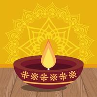 glückliche Diwali-Feier mit Kerze im gelben Hintergrund