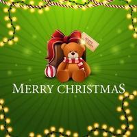 Frohe Weihnachten, grüne quadratische Grußkarte mit Girlanden und Geschenk mit Teddybär vektor
