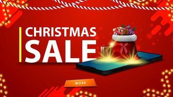 Weihnachtsverkauf, modernes Rabattbanner mit einem Smartphone. Santa Claus Tasche mit Geschenken wird von der Leinwand projiziert
