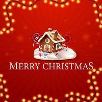 Frohe Weihnachten, quadratische rote Postkarte im Minimalismusstil mit Girlande und Weihnachtslebkuchenhaus mit Schlagsahne und Süßigkeiten