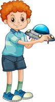 ein Junge, der Raketenspielzeugkarikaturfigur lokalisiert auf weißem Hintergrund hält