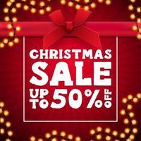 jul försäljning, Röda torget rabatt banner i form av nuvarande låda med krans ram vektor
