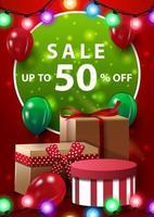 försäljning, upp till 50 rabatt, röd vertikal banner med ballonger, krans och gåvor vektor
