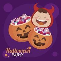 fröhliche Halloween-Party mit Teufel und Süßigkeiten im Kürbis