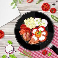 Draufsicht auf Frühstück in der Pfanne mit Lebensmittelelement auf dem Tisch