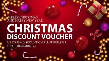 röd julkupong för ditt företag med present, godisrotting, julbollar, ballonger och krans, ovanifrån vektor