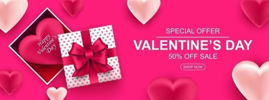 Alla hjärtans dag försäljning webb banner. realistisk presentask med rosett och hjärta.