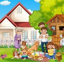lycklig familj som står utanför hemmet med sina husdjur