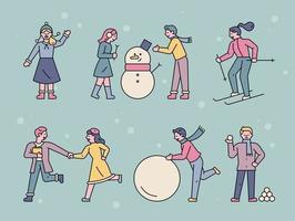 Leute, die an einem verschneiten Tag draußen spielen. vektor