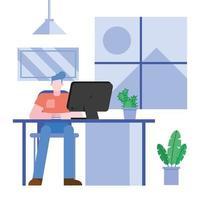 Mann arbeitet von zu Hause auf dem Schreibtisch