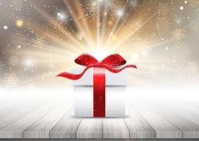Presentförpackning på ett träbord mot en julsnyggfluga backgro vektor