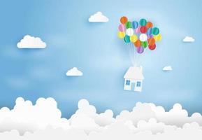 Papierkunst des Hauses, das von den bunten Luftballons hängt. vektor