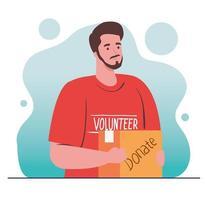 Freiwilliger Mann, der eine Spendentasche, ein Spendenkonzept für Wohltätigkeit und Sozialfürsorge hält