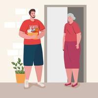 Freiwilliger Mann, der einer alten Dame mit Lebensmitteln hilft
