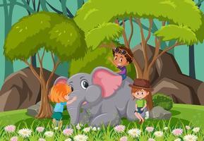 skogsscen med barn som leker med en elefant