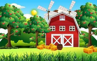 gårdsplats med röd ladugård och väderkvarn