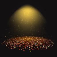 Guldstjärna konfetti under en strålkastare