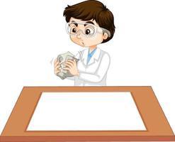 en pojke som bär forskarklänning med tomt papper på bordet vektor