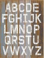 weiße Farbfarbe des Alphabets auf Retro-Farbhintergrund des Holzes. Vektorillustration.