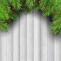 Julgran grenar på trä bakgrund vektor