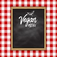 Vegansk meny tavlan på en kontrollerad tyg bakgrund