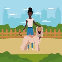 junge afro frau mit niedlichem hund auf dem feld vektor