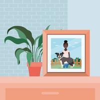 Bild der Afro-Frau mit dem niedlichen Hund im Feld vektor