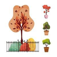 Herbstpflanzen mit Metallzaun und Keramiktöpfen