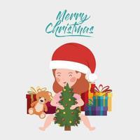 kleines Mädchen mit Kiefer und Weihnachtsgeschenkfeier