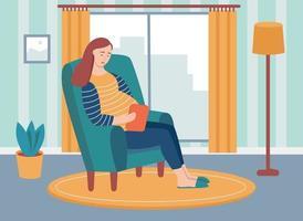 Eine junge schwangere Frau sitzt auf einem Stuhl und hält eine Tablette in den Händen. das Konzept der alltäglichen Aktivitäten und des täglichen Lebens. flache Karikaturvektorillustration.